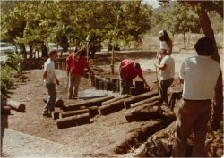 CIMC Youth workers building a retaining wall between the old Tribal Hall and today's Fire Dept. & Education Center in 1978.